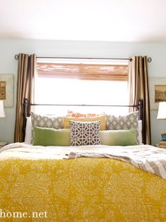 Yellow comforter with colorful pillows