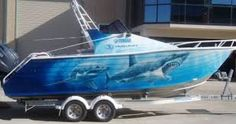 """""""WE'RE GOING TO NEED A BIGGER BOAT"""", THERE REALY IS NO END TO THE ITEMS OPEN FOR AIRBRUSH CUSTOM WORK. LET'S NOT FORGET THAT WHEN IN THE WATER MOST OF THIS ARTWORK WILL REMAIN UNSEEN. BUT WHEN ON THE TRAILER THESE GRAPHICS ARE GOING TO GRAB ATTENTION."""