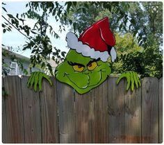 This is a fun way to decorate a fence for Christmas - Love It!