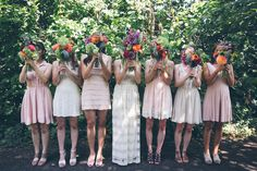 Neutral bridesmade dresses/multi colored bright flowers, lots of foliage
