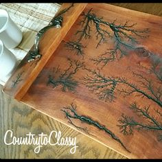 What a stunning wood serving tray! Using the fractal wood burning process #countrytoclassy #fractalwoodservingtray #dinnerservingtray #lichtenbergburningprocess #countrytray #rusticservingtray #electricburnedwood #birthdaygift #mothersdaygift #etsyshop