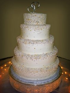 Each one of these sugar dragees was placed by hand with tweezers. Wedding cakes, 5 tier wedding cakes, specialty cakes, http://tiered-expressions.com
