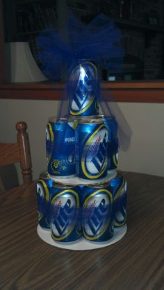 Beer can cake. 12 pk of Miller Lite, tape, tulle or ribbon, and cake boards = EASY!