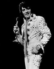 """Elvis on Tour""   1972, Metro-Goldwyn-Mayer  Partial Cast List: Elvis Presley, James Burton, Glen D. Hardin, Charlie Hodge, Jerry Scheff, Ronnie Tutt, John Wilkinson, Millie Kirkham, Estelle Brown, Sylvia Shemwell, Myrna Smith, Bill Baize, Ed Enoch, Donnie Sumner, JD Sumner,  Joe Guercio, Joe Esposito"