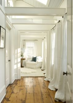 Beautiful hallway with wide timber floor boards all which decor- simply elegant. #hallway #timberfloorboards