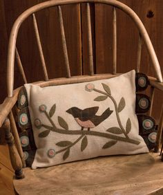 Cozy up any sofa or chair with this charming wool pillow - the tongues added on the sides make it extra special.