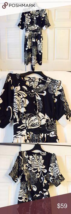 BCBGMaxAzria Black & White Dress XL Beautiful dress! Measures 37 inches shoulder to hem 22 inches waist to hem 18 inches waist across 21 inches armpit to armpit BCBGMaxAzria Dresses Midi
