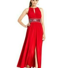R&M Richards Long Evening / Prom  Dress Gorgeous dress perfect for prom, a special occasion, wedding guest, etc. I wore this dress for 4hrs on a wedding party. Its in excellent condition. Size 6 regular. Red with silver details at the waist. R&M Richards  Dresses Prom