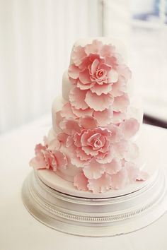 ABSOLUTELY love the look of the flowers on this one!! Its perfect except I would want the cake to be a little larger than the flower so the flower doesn't look like its overpowering the cake.