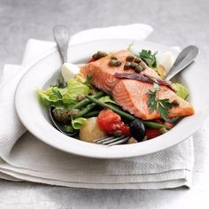 Delicious warm salad with salmon Ingredients: Salmon (large steak) — 1 PC. Beans (green) -150 gr. Tomatoes (better cherry) — 8-9 pieces. Potatoes — 3-4 PCs. Olives (Kalamata) — 8-9 pieces. Capers — 1 tsp. Salt — to taste Pepper — to taste Lemon (juice) — to taste Olive oil — 3-4 tbsp Preparation: 1. Pre-heat the oven to 180°C. 2. Tomatoes cut in half, spread on a baking sheet, sprinkle with salt and drizzle with olive oil. Put in the oven for 15-20 minutes. Tomatoes must be baked. Boil the…
