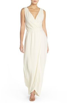 Free shipping and returns on Paper Crown by Lauren Conrad 'Bellingham' Tulip Hem Faux Wrap Crepe Gown at Nordstrom.com. A slender inset waist marries the décolleté bodice and slim column skirt of a wrapped-illusion gown cut from rich crepe. Finished with a charming tulip hem, this elegant dress flatters a multitude of figures.