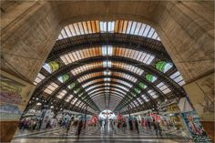 https://flic.kr/p/crSKcN | Milano Stazione Centrale 2012-06-25 161120 (not a fisheye) | <i> Dove fermano i treni parte un pò di vita, da dove fermano i treni e proprio là dove fermano i treni parte sempre un altro varietà parte sempre un nuovo varietà </i>  Some of you might remember that I asked advice on which location to choose for wideangle shots near Milano's central railway station. Well, I found that there's no better place than the station itself :) Enjoy the first of many shots of…