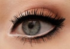 Nude/peach with white eyeliner below and Stark Black on top.