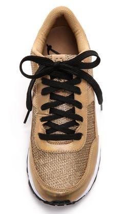 Gold athletic shoe.