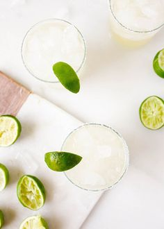 These ginger margaritas a bright and refreshing, a unique and delicious take on everyone's favorite tequila cocktail! Made with a homemade ginger simple syrup, these beverages only require a few ingredients and can be batched to serve a crowd! Refreshing Summer Cocktails, Easy Cocktails, Cocktail Recipes, Aquavit Cocktails, Rumchata Cocktails, Cheers, Gin, Beste Cocktails, Margarita Recipes