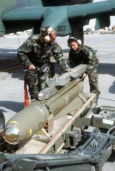 U.S. Air Force munitions specialists from the 23rd Tactical Fighter Wing, England Air Force Base, La., load an AGM-65 Maverick air-to-surface missile onto a U.S. Air Force A-10A Thunderbolt II attack aircraft prior to a sortie in support of Operation Desert Storm.