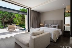 In this modern bedroom, large sliding doors open the bedroom up to the terrace, while a large chaise provides a place to relax. #ModernBedroom #BedroomDesign