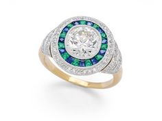 A Diamond, Emerald and Sapphire Ring
