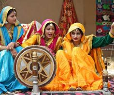 traditional indian women in the village.. spinning khadi cloth on the charkha