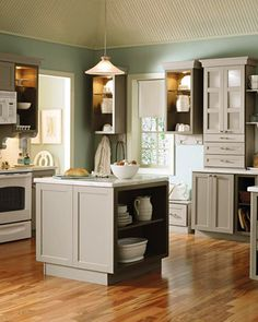 The kitchen that we will have! Cabinets, Cabinet color, corian counter and color, bench under window, and island may be a DIY but I want this one! Only difference is we will have white walls, tile floors, and white subway tile backsplash.