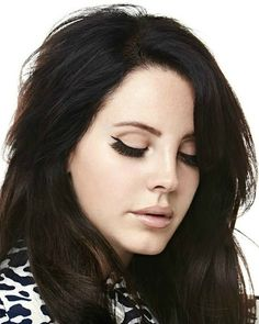 Lana Del Rey with dark hair.