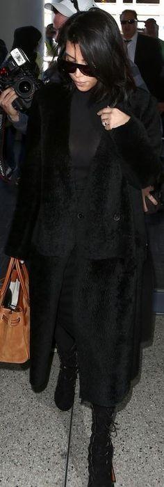 Kim Kardashian: Sunglasses – Saint Laurent  Purse – Hermes  Shoes – Alaia  Coat – Calvin Klein
