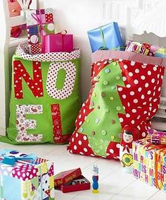 Sew Santa's sacks...followed the main pattern...used the top fold to put in a drawstring...so I didn't sew it all the way around to leave the opening for the drawstring!  LOVE THEM!! :)