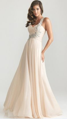 The color and one shoulder make the dress