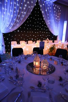 I like the draping of sheer fabric with the lights behind. Also like the bluish purple hue to the reception room.