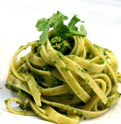 Fettuccine with Arugula-Basil-Kale Pesto by parsleyasagesweet: Lemony and garlicky, you can make this pesto 2 days ahead. Pour a thin layer of oil over pesto; cover and chill. #Pasta #Pesto #Pistachio