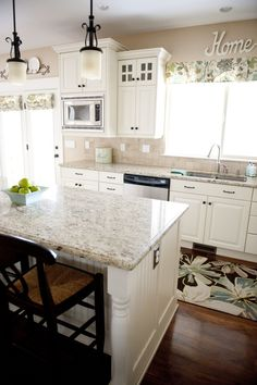 White kitchen idea -Roman Shade and window valance fabric: custom made from Laura Ashley Somerfield Seamist fabric -Barstools: Pottery Barn Napoleon Barstools -Green Dining Chairs: Pottery Barn Isabella Chairs -Rug: HomeGoods Kitchen Redo, New Kitchen, Kitchen Dining, Kitchen Ideas, Kitchen Cabinets, Dining Room, Kitchen Appliances, Family Room Design, Family Rooms