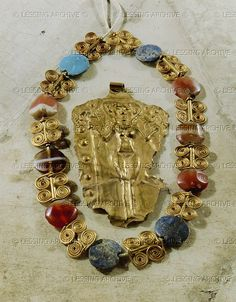 Necklace, gold wire, lapis lazuli and other semi-precious stones, and a pendant with a nude goddess. See 08-02-08/26 Late Middle Syrian period, from tomb 125, Mari (Tell Hariri), Syria   National Museum, Aleppo, Syria