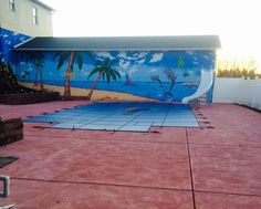 This is what I decided to to with the block wall by my pool, have a beach / tropical scene mural painted on it and I love it !!!!  Everyone of our friends love it too.