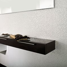 Cubica Blanco for the vanity wall in the ensuite & powder room