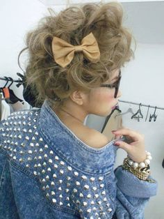 Madonna 1985: messy, teased hair with a bow. Try a black bow to match or a print bow for a pop of color.
