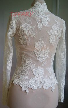 Unique beautiful wedding jacket-bolero. color : 1. ivory 2. white Bolero made with lace. Lace is hand-cut .Fastened at the front Bolero length below the waist. Long sleeve -60 cm--23,5 inch . (it be able to be shorter ) 3/4 sleeve- 46 cm--18 inch short sleeve These are my pictures, this