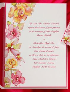 Subtle watercolor flowers adorn this striking invitation. A thin hot pink border frame ties everything together.