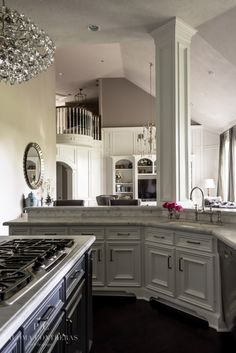 A Glamorous Makeover: Paloma Contreras Design  #kitchen #lighting #carrara #whitecabinets #greyisland