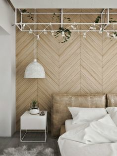 Headboard wall features wooden chevron panelling