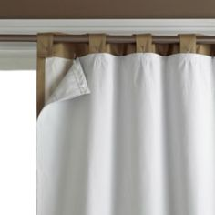 Use Velcro to add a black-out panel to curtains... could this also work to add a waterproof panel to make a shower curtain?  I think so!