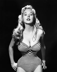 Pin-up model Betty Brosmer c. 1950s...If she had her hair in a ponytail, she'd look just like the original Barbie doll, bathing suit and all!