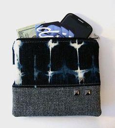 Tote this bleached denim zipper pouch as a pared down clutch, makeup bag or purse organizer.