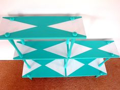 Simple bright bookcase made even cooler with a simple white pattern