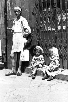 Warsaw Ghetto, Poland, A young woman and two little girls on Leszno St. They did not survive