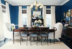 IDEA!    Mix Bold Decor    This dining room caught our eye in a big way with its bold blue-and-white palette. The walls painted in a vivid blue and the oversize white armchairs are stark contrasts that give the space polished appeal. Conversely, for a room with white walls, don't be afraid to add deep-blue accents and furnishings with elaborate blue-and-white patterns.    PHOTO: PATRICK CLINE/LONNY MAGAZINE