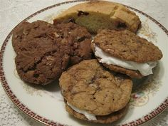 a trio of Christmas cookie s: Oatmeal Sandwich Cookies (check out the filling, they used fluff) German Chocolate Toffee Cookies & a White Chocolate-Cranberry Biscotti