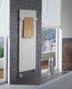 Vertical flat panel radiators, perfect for bathrooms.