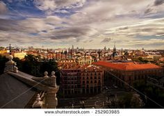 Beautiful Madrid city scene with cloudy sky, view from roof, High dynamic range - stock photo