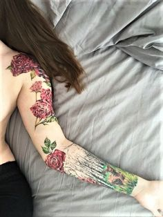 Flowers and deer colored sleeve tattoo