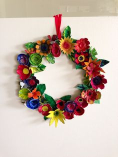Spring egg carton wreath. Love the colors and it's inexpensive and easy to make.